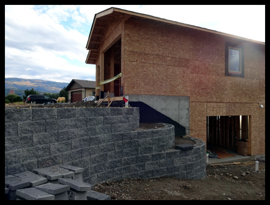 Building a Home in Coldstream, Third Month, custom electrical options and the retaining wall is coming together.