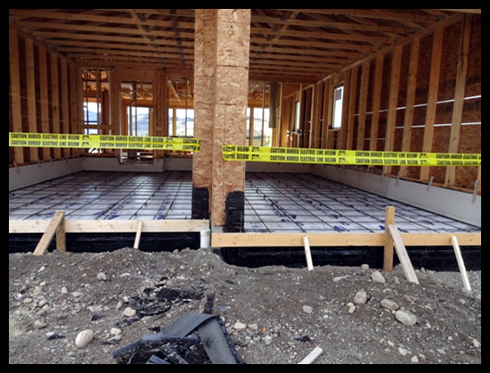 Building a Home in Coldstream, Third Month, messy water proof membrane goes on the garage floor before the concrete.