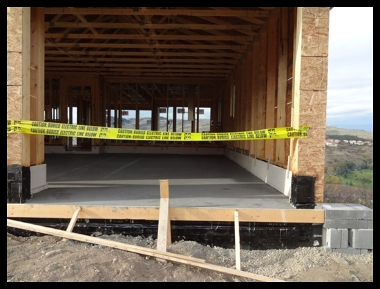 Building a Home in Coldstream, Third Month, basement has a nice concrete pour job.