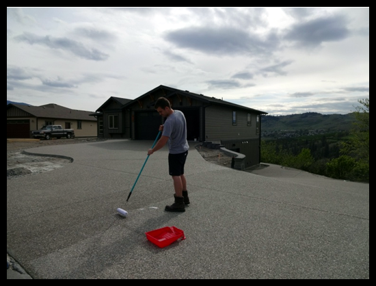 Building a Home in Coldstream, Eighth Month, my son helped with sealing the driveway.