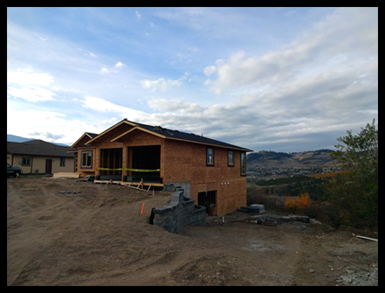 Building a Home in Coldstream, Third Month, asphalt shingles have been installed.