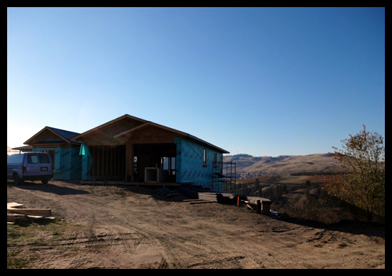 Building a Home in Coldstream, Fourth Month, the house is wrapped and hardi board is next.